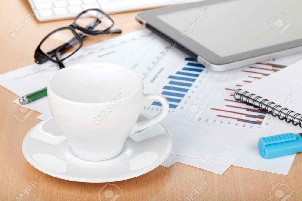 19297140-coffee-cup-on-contemporary-workplace-with-financial-papers-computer-glasses-and-office-supplies.thumb.jpg.e34861d06a74c20bb72702debb85ecfc.jpg
